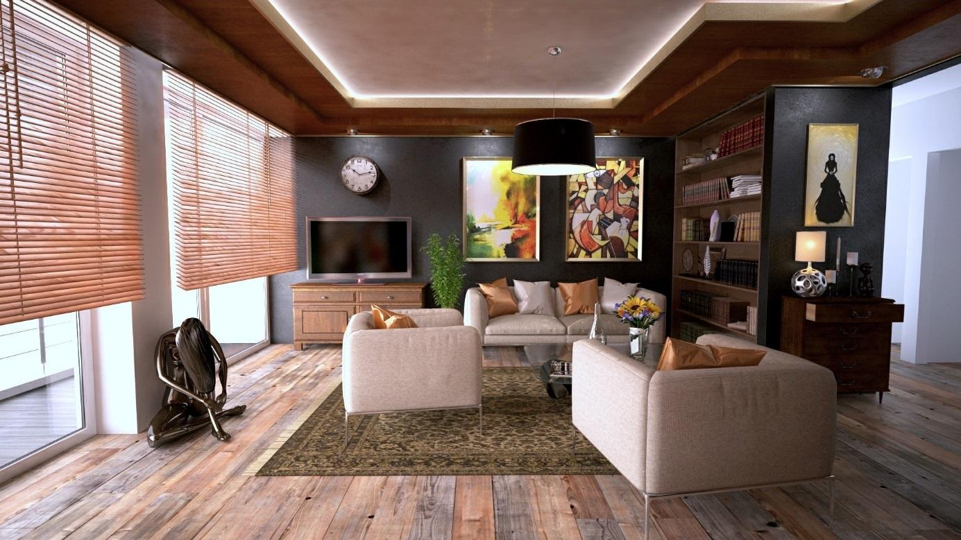Modern eingerichtetes Wohnzimmer mit Regal, Couch und Sesseln